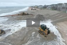 Video: Duck's beach is busy as dredge and dozers go to work