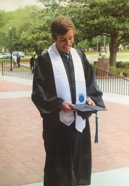 Photo #1: 2017 UNCW graduate Charles Shotton experiencing his first moments no longer a student. Charles was the 2013 recipient of the Davis Scholarship.