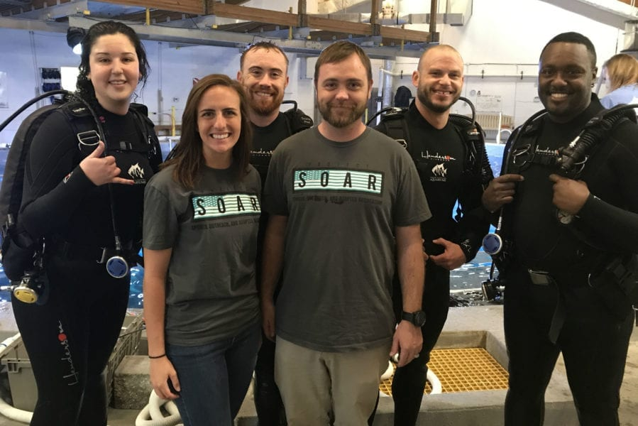 Veterans dive with sharks at N.C. Aquarium on Roanoke Island