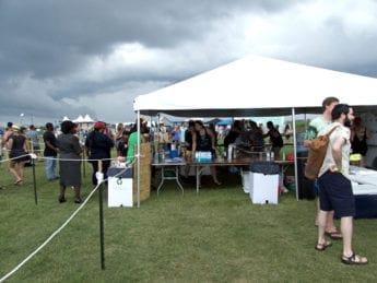 Storm clouds over the beer and wine tent. Although it looks ominous, the rain held off. (Kip Tabb)