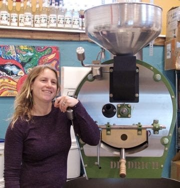 Ashley Barnes and the roaster used to create the coffee for Ashley's Espresso Parlour.Photo Kip Tabb