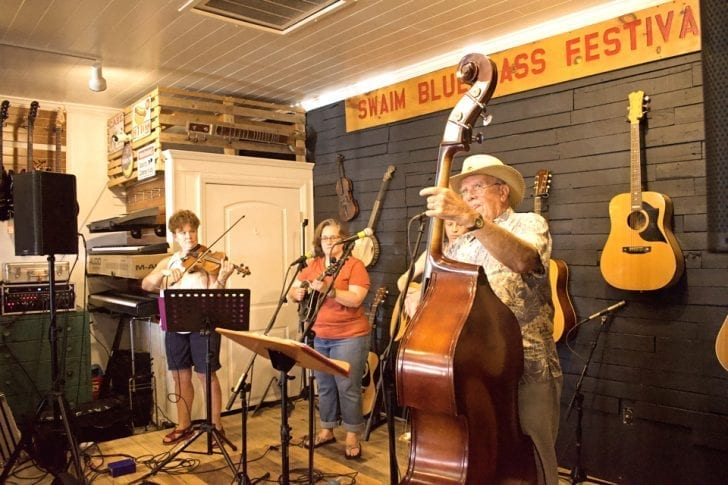 Some bluegrass inside at the Jubilee Music Grand Opening and Fundraiser. Photo, Kip Tabb